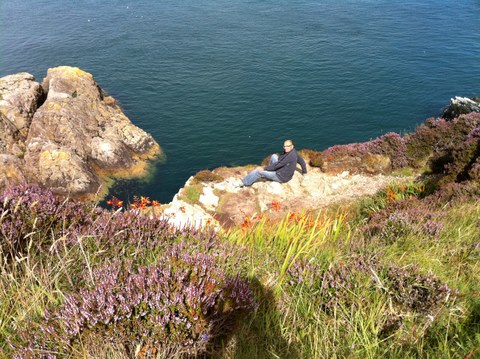 sitting on top of the cliff looking down