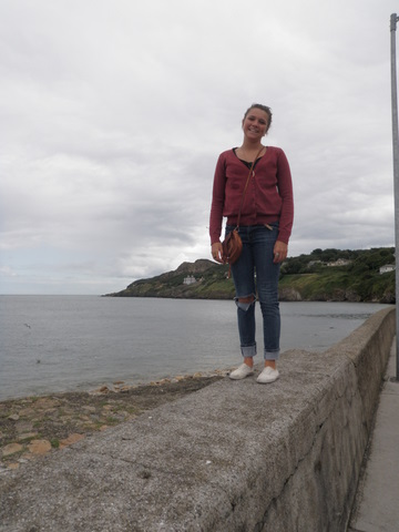 Nadia standing on a wall