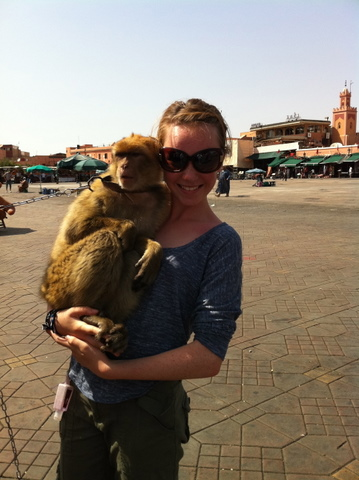 Isabelle with a poor chained Barbarie monkey