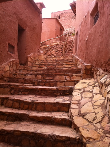 A street in Ait Benhaddou with concrete and stones probably to prevent erosion