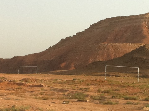 Soccer in the desert, dry and dusty field near Ait Benhaddou