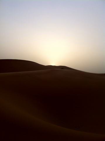 Sun setting on the enormous dunes of Erg Chebbi