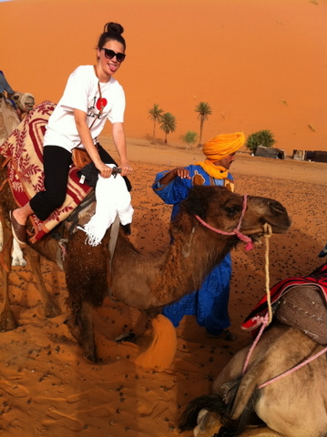 Nadia mounting the camel
