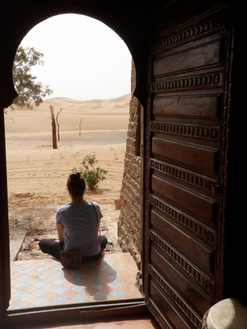Nadia at the door of the desert at the Cafe du Sud
