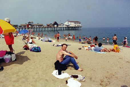 Relaxing in Old Orchard Beach with the pier behind
