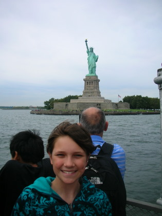 Nadia in front of the Statue of Liberty