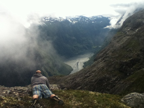 Myself looking at the waters below, the spectacular Naeroyfjord