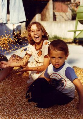 Ginette and Jimmy playing in the corn in Serredade