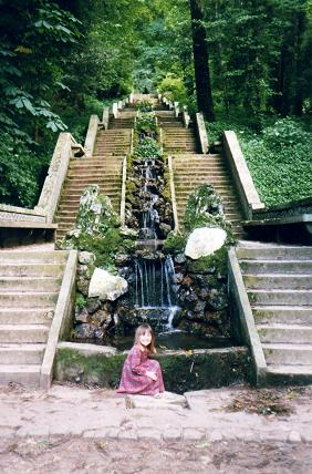 Nadia in front of the 144 steps and the small cool waterfall