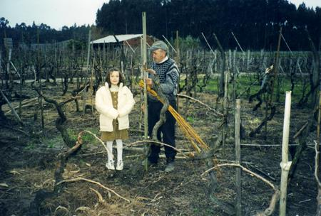 My dad tying the vines while Nadia watches