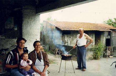 Dad barbecuing some of his famous pork (Nadia seven months old)