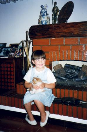 Nadia playing with a kitty.