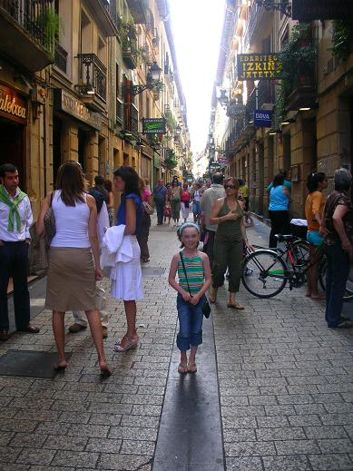 Isabelle in a animated old street, Parte Vieja San Sebastian