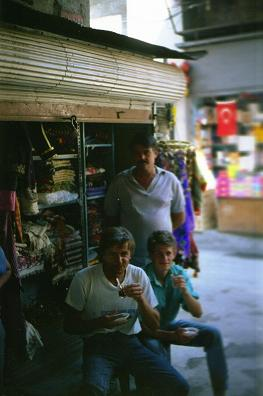 Owner of a store sharing tea a Turkish tradition