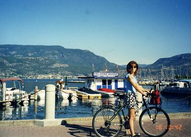 Ginette cycling in front of the Kelowna Marina