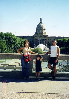 Ginette, my sister with Eric and Isabelle in front of the Legislature building in Edmonton