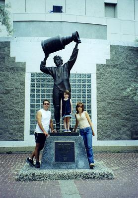 Isabelle with Eric and Ginette in front of Wayne Gretzky statue in Edmonton