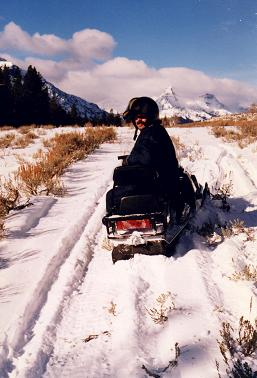 Gilbert on his snowmobile near Cooke City, Montana