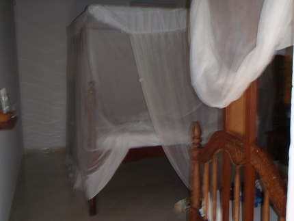 Our first room with the traditional mosquito net