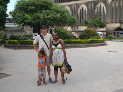 Mike, Maguy and Caleb in front of the Anglican Church