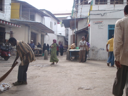 Man sweeping street