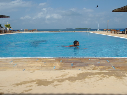 Lucas swimming in the pool of the hotel